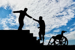 Man helps disabled person with prosthesis on stairs day Royalty Free Stock Photo
