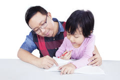 Man helps his child doing homework Royalty Free Stock Image