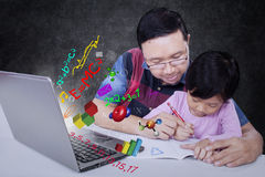 Man helps his daughter to study Stock Photos