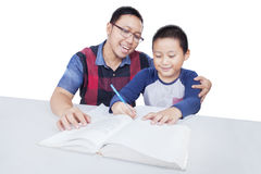 Man helps his son to study Royalty Free Stock Photo