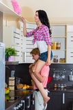 Man helps his wife in cleaning Royalty Free Stock Image