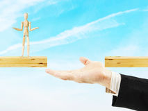 Man helps other to cross the chasm Stock Photo