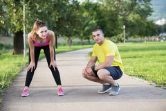 Man helps to woman with injured knee at sport activity Royalty Free Stock Photos