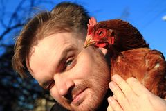 Man and her chicken Royalty Free Stock Photos