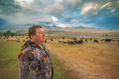 A man and a herd of goats and sheep Stock Image