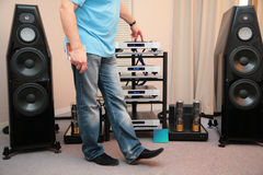 Man and hi-end audio system. The Man and hi-end audio system royalty free stock photo