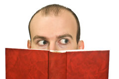 Man hidden behind the book Stock Images