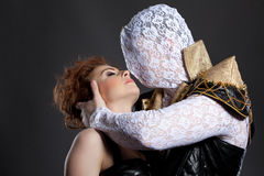 Man with hidden face kissing his redhead partner Stock Photo