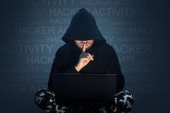 Computer hacker stealing data from a laptop royalty free stock images