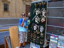 The man hidden under a mask Stock Photography