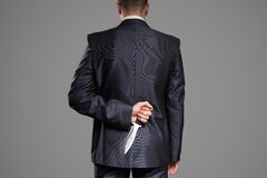 Man hide knife behind back. Killer concept. Stock Image