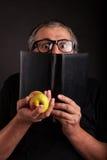 Man hides behind big sleek leather book Royalty Free Stock Images