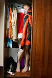 A man hiding. In the closet Stock Image