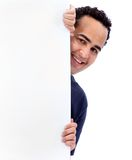 Man hiding behind a banner Royalty Free Stock Photos