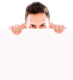 Man hiding behind banner Royalty Free Stock Image