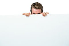 Man hiding behind board Royalty Free Stock Photography