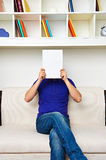 Man hiding behind empty placard Stock Images