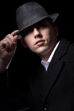 Man hiding behind his hat Royalty Free Stock Image