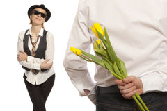 Man hiding bouquet flowers Royalty Free Stock Image