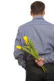 Man hiding bouquet flowers Royalty Free Stock Photography