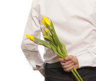 Man hiding bouquet flowers Stock Photos