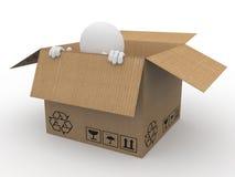 Man hiding in a cardboard box, scared Royalty Free Stock Photos