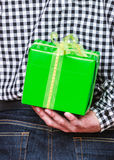 Man hiding gift box behind back. Holiday surprise. Royalty Free Stock Photos
