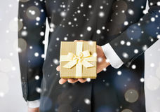 Man hiding gift box Stock Image