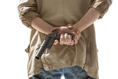 Man hiding gun behind his back Stock Photography