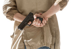 Man hiding gun behind his back Stock Image