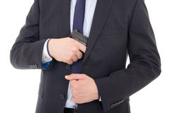 Man hiding gun isolated on white Stock Image