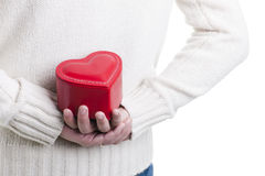 Man hiding a heart shaped box Royalty Free Stock Images
