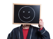 Man hiding his face with a billboard Royalty Free Stock Photos