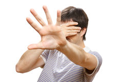 Man hiding his face with the hands. On white background Stock Photography