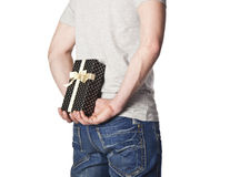 Man hiding a present Stock Photo