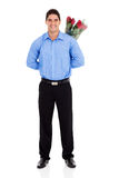 Man hiding roses Royalty Free Stock Photo