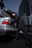 Man hiding something in the trunk. Man hiding something in his cars trunk Stock Photography