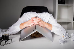 Man hiding under laptop Stock Photography