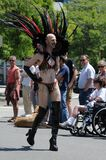 Man in high boots and headdress at Gay Pride Parade Royalty Free Stock Image
