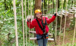 Man in high rope course climbing for sport Stock Image