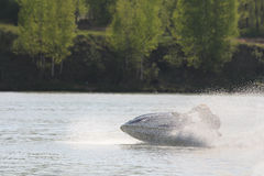 A man on high-speed chase on the jet ski. Royalty Free Stock Photos