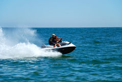 Man on a high speed jet ski Stock Photo
