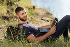 Man on hike in nature using digital tablet Royalty Free Stock Images