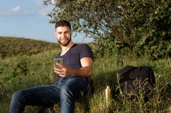 Man on hike in nature using phone Stock Photo
