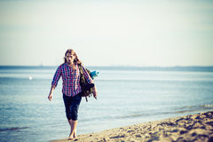 Man hiker with backpack tramping by seaside Royalty Free Stock Photo