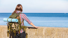 Man hiker with backpack tramping by seaside Stock Photography