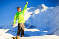 Man hiker or climber accomplish in winter mountains. Inspiration and motivation achievement business concept. Success climbing on snow, beautiful inspirational royalty free stock photo