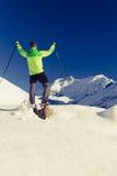 Man hiker or climber accomplish in winter mountains. Inspiration and motivation achievement business concept. Success climbing on snow, beautiful inspirational stock photos