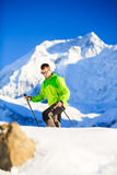 Man hiker or climber accomplish in winter mountains. Inspiration and motivation achievement business concept. Success climbing on snow, beautiful inspirational stock image
