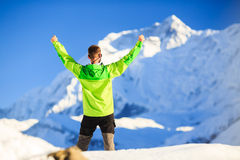 Man hiker or climber achievement in winter mountains Royalty Free Stock Images